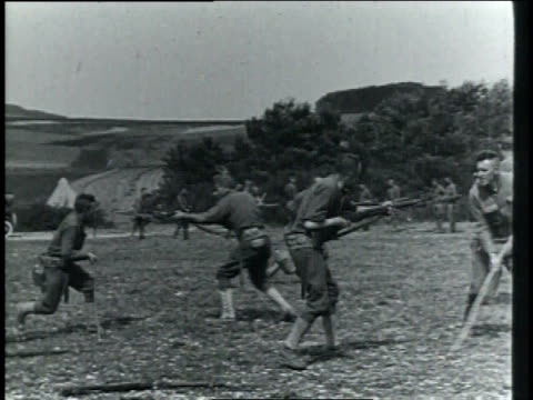 1910s ws soldiers sparring with each other and practicing with bayonets in field / germany - bayonet stock videos & royalty-free footage