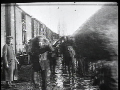 1910s soldiers unloading provisions from a train / kars, austria - turkey middle east stock videos & royalty-free footage