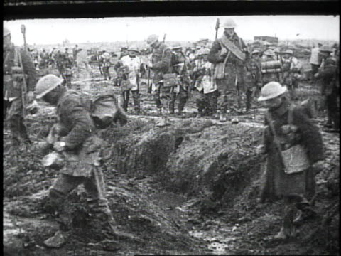 1910s soldiers walking through a muddy trench / kars, austria - british military stock-videos und b-roll-filmmaterial
