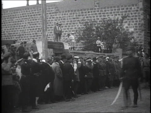 1910s spectators watching and soldiers marching past the stand in a review / kars, austria - turkey middle east stock videos & royalty-free footage