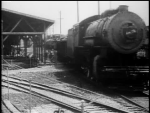 b/w 1910s steam train pulling out of station - authority stock videos & royalty-free footage