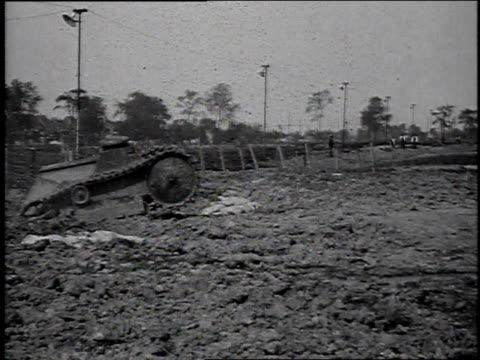1910s test tank rolling across dirt field / highland park, michigan, united states - wwi tank stock videos & royalty-free footage