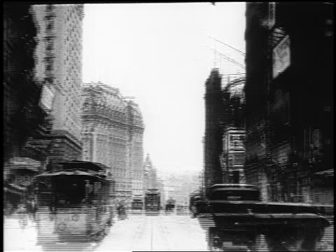 b/w 1910s trolley point of view up broadway past hotel albany / nyc / documentary - 1910 stock-videos und b-roll-filmmaterial