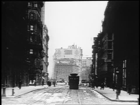 b/w 1910s trolley point of view up broadway (flatiron district) past men doing road construction / nyc / doc. - 1910 stock-videos und b-roll-filmmaterial