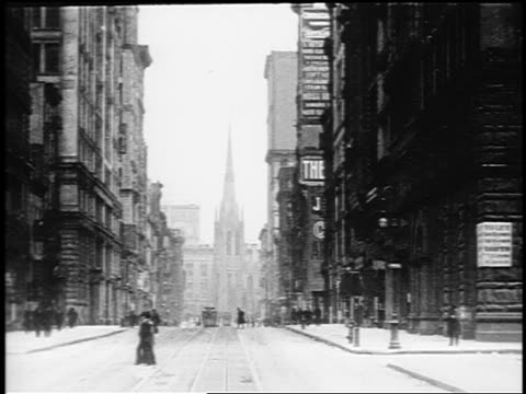 stockvideo's en b-roll-footage met b/w 1910s trolley point of view up broadway towards grace church / nyc / documentary - 1915