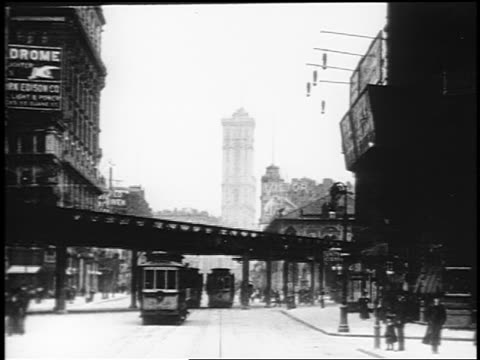 stockvideo's en b-roll-footage met b/w 1910s trolley point of view up broadway under elevated train tracks / nyc / documentary - 1915
