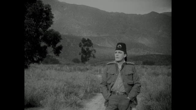 1910s turkish man (house peters) anxiously walks through the countryside - 1910 stock-videos und b-roll-filmmaterial
