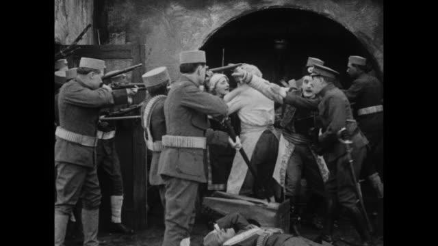 1910s turkish troops invade a bar - bar点の映像素材/bロール