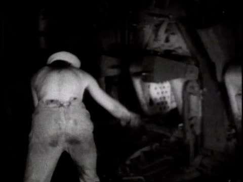 1910s / us navy sailor shoveling coal into furnace / usa - us navy stock videos & royalty-free footage
