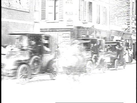 vidéos et rushes de 1910s ms vehicles driving on street / france - taxi