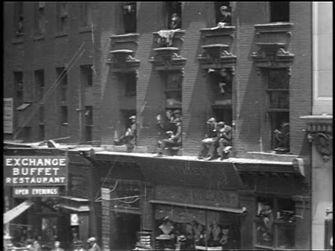 vídeos y material grabado en eventos de stock de b/w 1910s wall street brokers leaning out of windows + sitting on ledges signaling / nyc - 1910