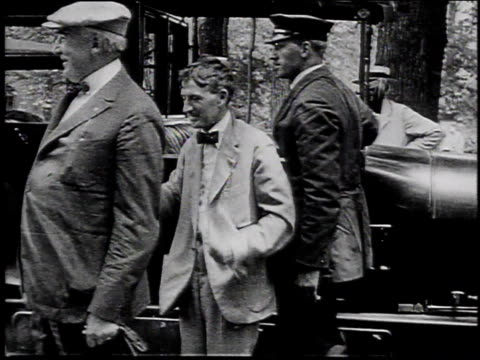 1910s ms warren g harding and harvey firestone shaking hands upon arriving in the great smokey mountains / north carolina united states - appalachian mountains stock videos & royalty-free footage