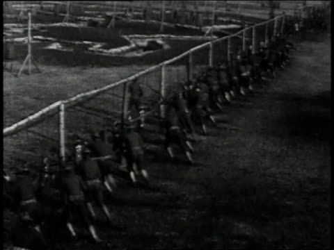 1910s waves of recruits in training charging hanging bags during bayonet practice / united states - bayonet stock videos & royalty-free footage