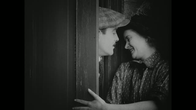 1910s when a man proposes marriage as a solution, a woman gives into temptation - silent film stock videos & royalty-free footage