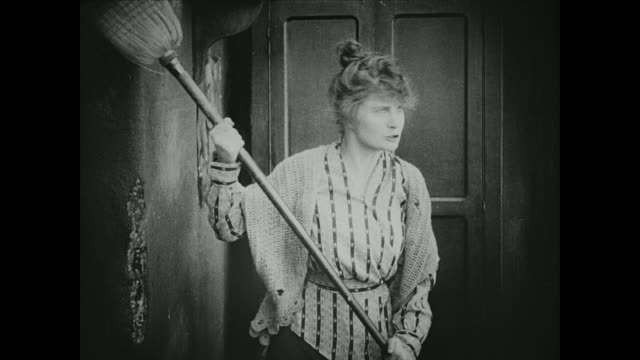 1910s When accused of being an unfit mother, a less fortunate woman swats her wealthy accusers away with a broom