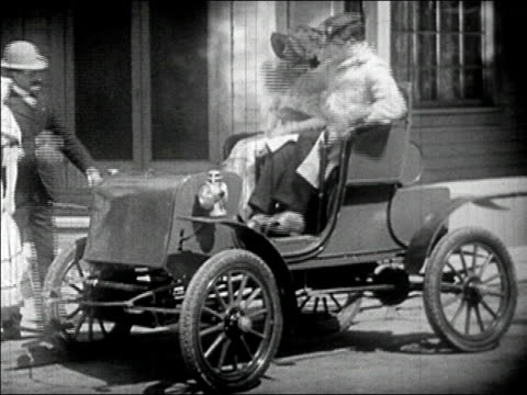 1910s wide shot couple sitting in old car and opening additional seat in front/ second couple sits down/ audio - bonnet stock videos & royalty-free footage