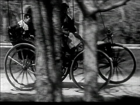 1910s Wide shot early automobile hitting bumps on road/ AUDIO