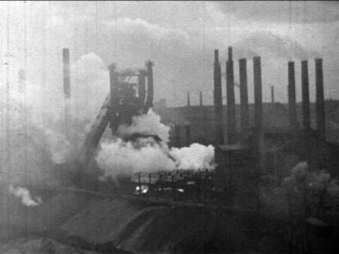 b/w 1910s wide shot factory + smokestacks with billowing smoke / newsreel - smoke stack stock videos & royalty-free footage
