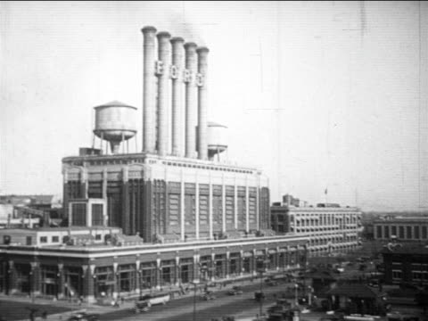 B/W 1910s wide shot giant Ford factory with smokestacks / Highland Park, Michigan / documentary