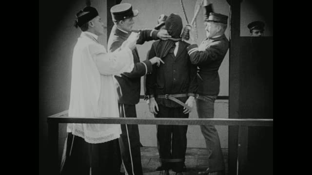 1910s with only seconds to spare, a death row inmate is saved from execution - hinrichtung stock-videos und b-roll-filmmaterial