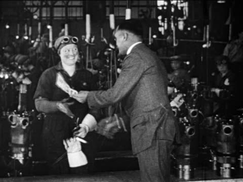 b/w 1910s woman defense factory worker shakes hands with man in suit / documentary - 1910 stock videos & royalty-free footage