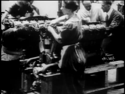 1910s women working on engine in warplane factory / wwi - manufacturing occupation stock videos & royalty-free footage