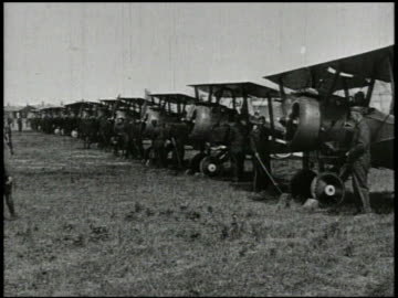 united states soldiers wheeling out biplane fighter aircraft from hangar, row of biplanes on field, ace pilot edward rickenbacker sitting in plane,... - world war one stock videos & royalty-free footage