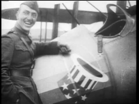 b/w 1910s world war i flying ace eddie rickenbacker posing next to plane smiling / doc - eddie rickenbacker bildbanksvideor och videomaterial från bakom kulisserna
