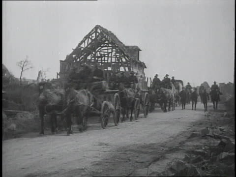 1910s wwi british cavalry, horses and carts and infantry traveling country road / france - cavalry stock videos & royalty-free footage