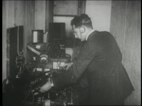 b/w 1910s/20s 2 men wearing headphones + operating early radio station - radio studio stock videos & royalty-free footage