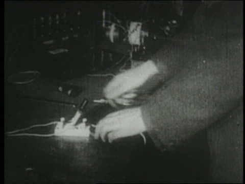 b/w 1910s/20s hands of man operating early wireless station - radio studio stock videos & royalty-free footage