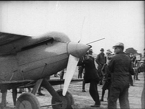 b/w 1910s/20s man starting prop plane - propeller stock videos & royalty-free footage