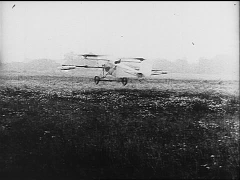 b/w 1910s/20s rear view long shot man attempting to take off in early airplane with rotors on wings - air vehicle stock videos & royalty-free footage