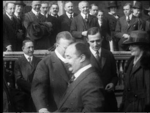 b/w 1910s/20s ms teddy roosevelt shaking hands with line of people outdoors - theodore roosevelt us president stock videos & royalty-free footage