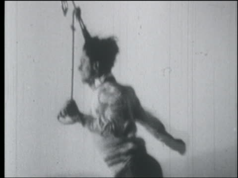 b/w 1920s aerial man hanging from biplane in air by head / makes kissing gesture with hands - only young men stock videos & royalty-free footage