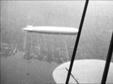 B/W 1920s airplane point of view above Graf Zeppelin flying over New York City