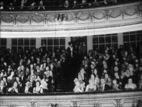 stockvideo's en b-roll-footage met b/w 1920s audience in balcony of theater clapping vigorously / paris / newsreel - applaudiseren