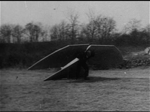 aviation ws early helicopter autogiro 'sky car' bouncing up/down in field male w/ attached 'tail' 'wings' running in field jumping off boulder... - rymdindustri bildbanksvideor och videomaterial från bakom kulisserna