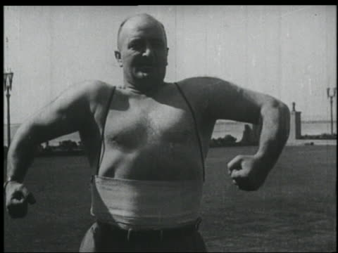 b/w 1920s bare-chested man (fa/jr? richards) flexing outdoors - flexing muscles stock videos and b-roll footage