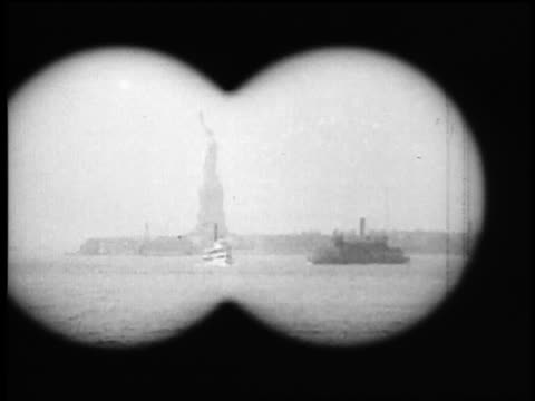B/W 1920s binoculars point of view from boat of Statue of Liberty / NYC / documentary