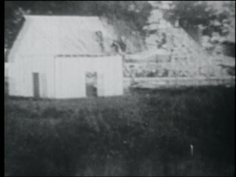 b/w 1920s biplane crashing into shack - airplane crash stock videos and b-roll footage