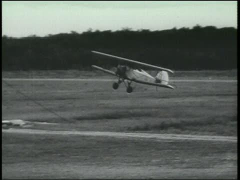 b/w 1920s biplane crashing into wall - airplane crash stock videos and b-roll footage