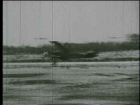b/w 1920s pan biplane on ground crashing into house - airplane crash stock videos and b-roll footage