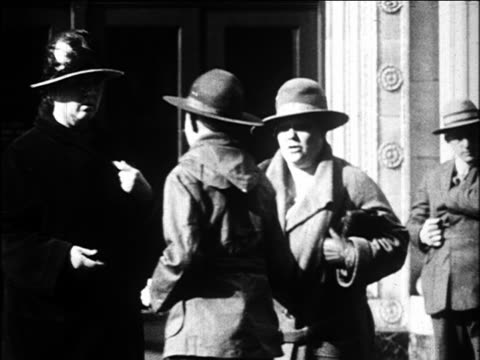 b/w 1920s boy scout preventing 2 women from crossing street / oakland, california / newsreel - scout association stock videos & royalty-free footage