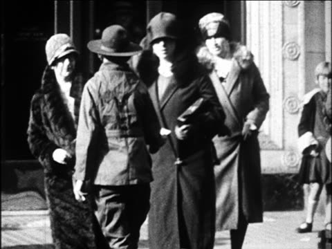 b/w 1920s boy scout talking to flappers trying to cross street / oakland, california / newsreel - scout association stock videos & royalty-free footage