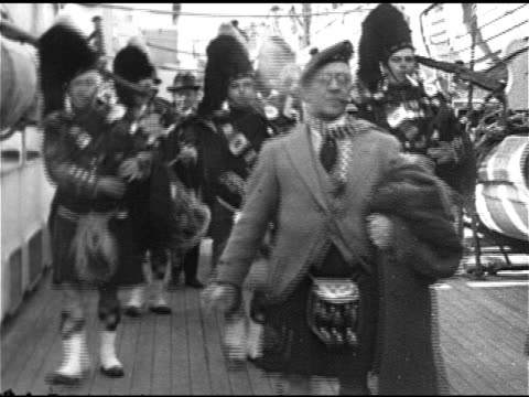 british entertainment scottish entertainer music hall comedian harry lauder leading bagpipers on deck of ship ms tu harry in traditional scots... - knee highs stock videos and b-roll footage