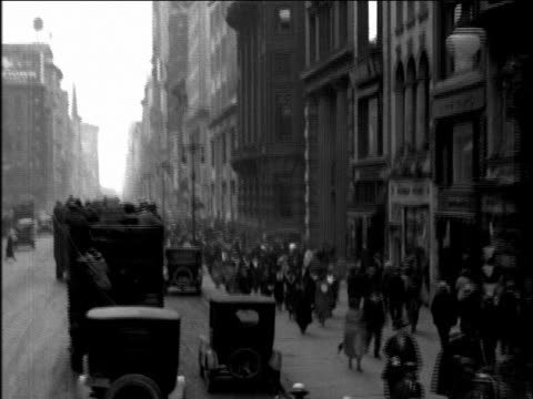 b/w 1920s bus point of view behind double decker buses on nyc street / newsreel - dubbeldäckarbuss bildbanksvideor och videomaterial från bakom kulisserna