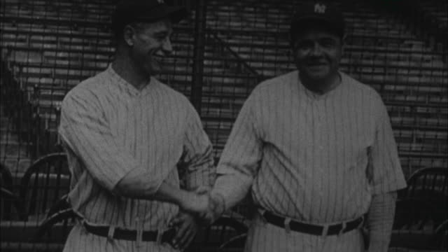 1920s b/w ms babe ruth and lou gehrig stand together / united states - lou gehrig stock videos & royalty-free footage