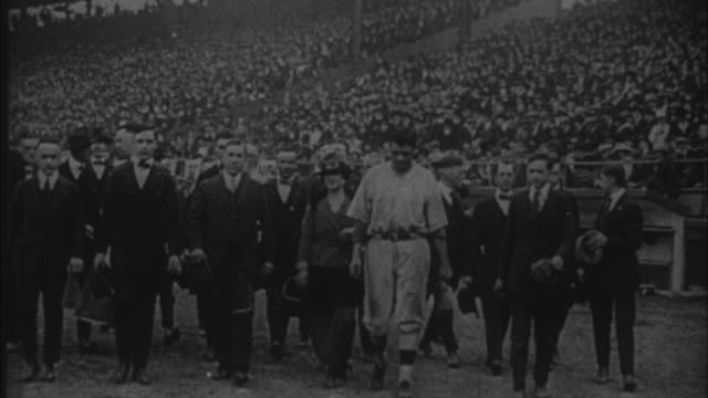1920s B/W WS Babe Ruth walks in ballbark ahead of some dignitaries / United States