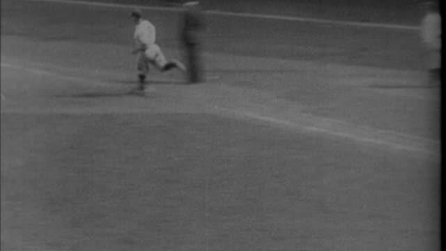 1920s b/w ws ha ts baseball player hitting home run and circling bases / new york city new york usa - home run stock videos & royalty-free footage